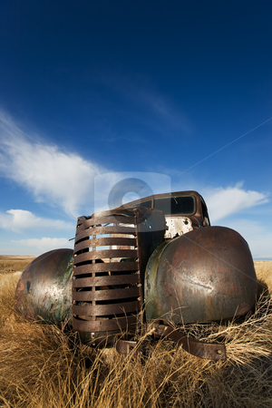 Vintage truck stock photo, Vintage truck abandoned and rusting away in the prairies by Steve Mcsweeny