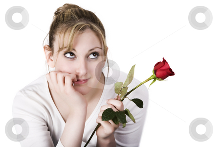 Dreaming teen stock photo, A pretty teen holding a rose isolated on white by Steve Mcsweeny