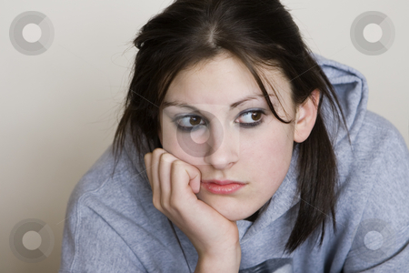 Boredom stock photo, Bored teenager looking depressed, with a grey background by Steve Mcsweeny