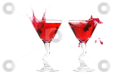 Double splash stock photo, A double martini olive splash on a white background by Steve Mcsweeny