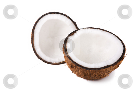 Coconut halves stock photo, Two halves of a coconut on white background (focus on front piece) by Steve Mcsweeny