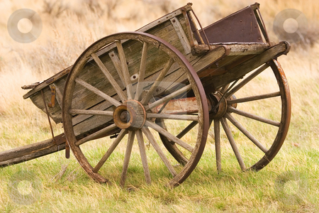 Old wagon stock photo, Rusty old wagon out in the field by Steve Mcsweeny