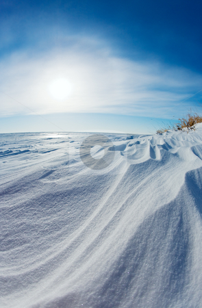 Snow dunes stock photo, Wind swept snow dunes on a frozen lake shore by Steve Mcsweeny