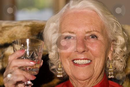 Enjoying life stock photo, Beautiful elderly woman in her eighties enjoying a drink by Steve Mcsweeny