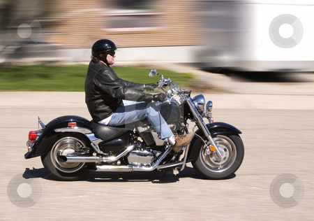 Ride stock photo, Man enjoying a motorcycle ride in the city (motion blur) by Steve Mcsweeny