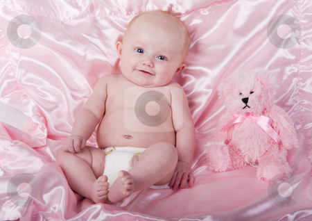 Baby and bear stock photo, A baby girl on a pink blanket with a teddy bear by Steve Mcsweeny
