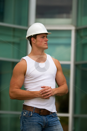Fit construction worker stock photo, A fit construction worker in jeans and muscle shirt by Steve Mcsweeny