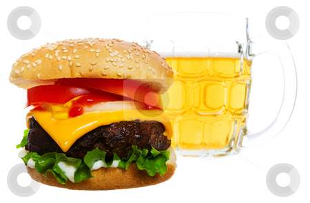 Burger and beer stock photo, Big Juicy cheese burger with a beer in the background by Steve Mcsweeny