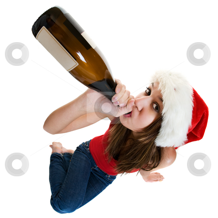 Christmas drink stock photo, A woman wearing a santa cap drinking champagne. by Steve Mcsweeny