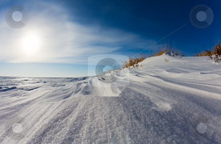 Snow drift stock photo, Wind swept snow on a frozen lake shore by Steve Mcsweeny