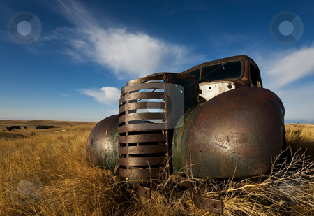Old truck stock photo, Vintage truck abandoned and rusting away in the prairies, ghost town in the background by Steve Mcsweeny