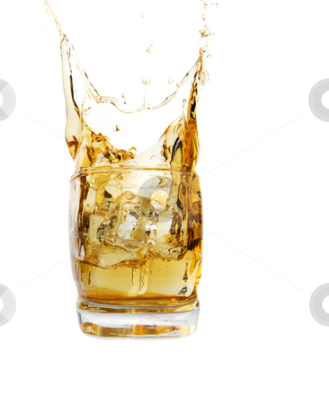 Whiskey splash stock photo, A glass of whiskey with ice cube splash by Steve Mcsweeny