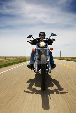 Bike travel stock photo, A biker speeding on a rural road by Steve Mcsweeny