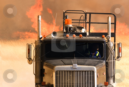 Fire water truck stock photo, Water truck fighting a large grass fire by Steve Mcsweeny