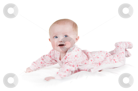 Happy baby girl stock photo, A smiling  baby girl on a white sheet in Pajamas. by Steve Mcsweeny