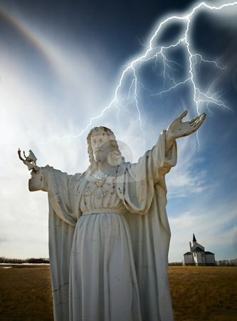 Christ statue stock photo, Statue of christ with lightning and church in the background by Steve Mcsweeny