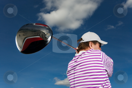 Golf swing stock photo, A golfer swinging a large driver (focus on golf club) by Steve Mcsweeny