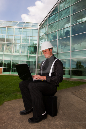 Young foreman stock photo, A young business man using a laptop outside by Steve Mcsweeny