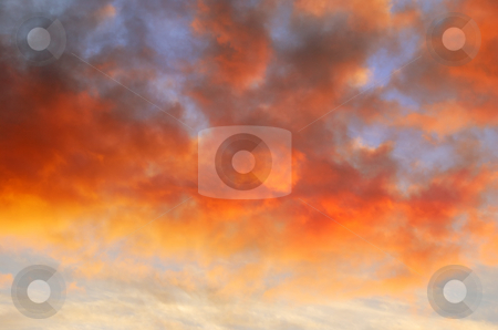 Orange Clouds at Sunset stock photo, Orange clouds at sunset contrasting the blue sky. by Denis Radovanovic