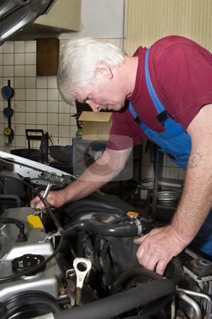 Car mechanic stock photo, A car mechanic servicing a vehicle by Corepics VOF