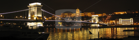 Budapest panorama with Chain bridge and royal palace stock photo, Panorama shot of Budapest Chain Bridge and royal palace at night by Alessandro Rizzolli