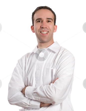Smiling Man High Key stock photo, A young man wearing a white dress shirt is standing with his arms crossed and smiling at the camera by Richard Nelson
