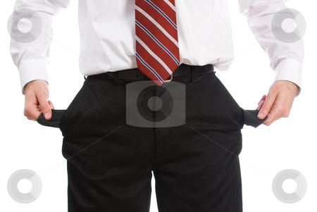 Broke Businessman stock photo, An unemployed business man holding out his empty pockets showing that he has no money, isolated against a white background by Richard Nelson