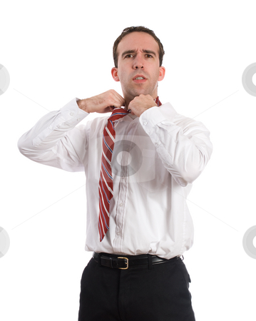 Frustrated Businessman stock photo, A frustrated businessman loosening his tie, isolated against a white background by Richard Nelson