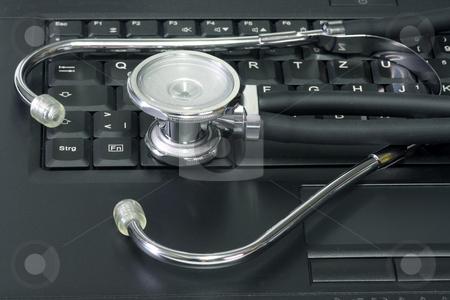 Keyboard stock photo, Stethescope on a keyboard from a laptop. Shot in Studio by Birgit Reitz-Hofmann
