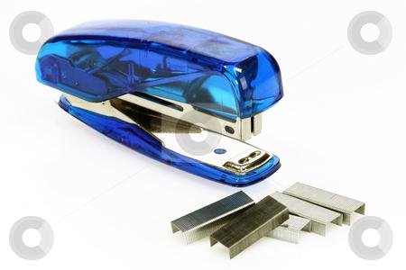 Office stapler stock photo, Office stapler and clips on bright background by Birgit Reitz-Hofmann