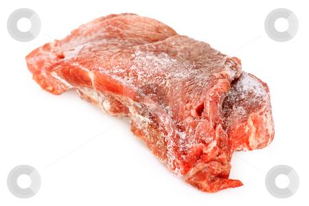 Frozen meat stock photo, Frozen pork meat on bright background by Birgit Reitz-Hofmann
