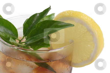 Lemon ice tea stock photo, A glass full of Ice Tea with a lemon slice on bright background by Birgit Reitz-Hofmann