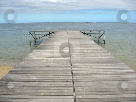 Wooden pier stock photo, Wooden pier on a tropical beach in Mauritius. by Ingvar Bjork