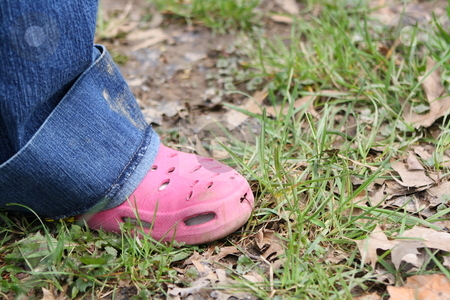 Pink shoe stock photo, Pink shoe in the grass by Chris Torres