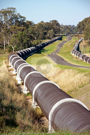 Water Lifeline stock photo, A pair of large concrete water pipes used for the distribution of water from a dam to the suburbs. by Adam Goss