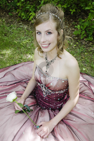 Freckled Beauty stock photo, Fair, freckled beauty in elegant formal prom dress, holding a single sem white rose.  Dappled light. by Brenda Carson