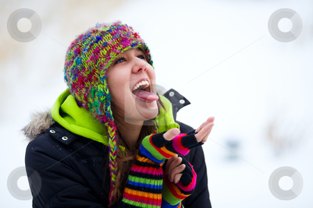 Catching Snowflakes stock photo, A teenage girl trying to catch falling snowflakes on her tongue. by Brenda Carson