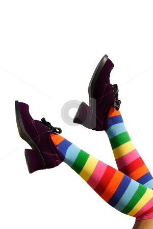Happy Kicking Feet stock photo, Striped knee-hi socks and wickedly wonky, purple suede shoes on isolated girl's legs. by Brenda Carson