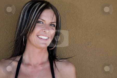 Thirty Something stock photo, Portrait of a beautiful woman in her early thirties against a neutral earthtone colored wall. by Brenda Carson