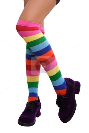 Crazy Legs stock photo, Pretty legs in a crazy combination of multi-colored striped knee-his by Brenda Carson