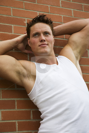 Male Beauty stock photo, A handsome young man with well-defined muscles. by Brenda Carson