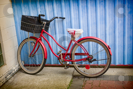 Retro Bicycle stock photo, Old, 1950's era, red bike leaning against a blue wall. by Brenda Carson