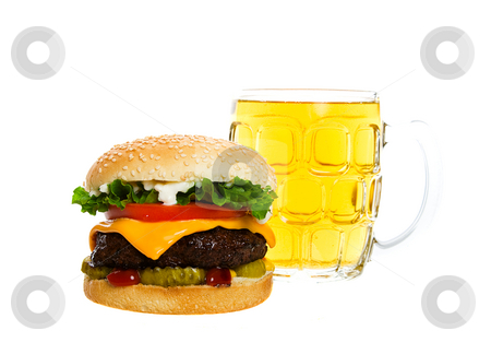 A Beer and a Burger stock photo, Juicy Angus beef burger topped with cheese, tomatoes & lettuce on a golden sesame seed bun along with a thirst quenching mug of beer.  Shot on white background. by Brenda Carson