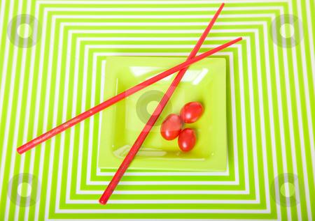 Geometric Tomatoes stock photo, Eye-popping tomato & chopstick still life on geometric patterned mat. by Brenda Carson