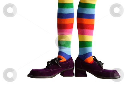 Clown Feet Isolated stock photo, Wacky clown feet with crazy striped socks and oversized purple suede shoes!  Isolated. by Brenda Carson