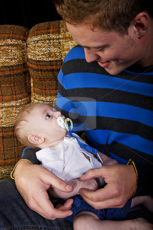 New Father stock photo, A nervous new father holds his son. by Brenda Carson