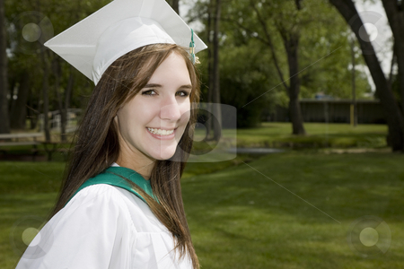 Smiling Graduate Girl stock photo, A happy, smiling girl in graduation cap & gown. by Brenda Carson