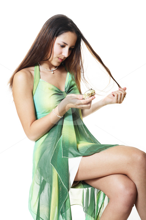 Hair Problems stock photo, A cute, african-american/caucasian woman checks out the condition of her straightened hair and seems unhappy with it's condition by Brenda Carson