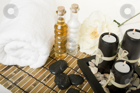 Spa Essence stock photo, Bath & spa products with massage stones, oil essences & aromatic candles. by Brenda Carson