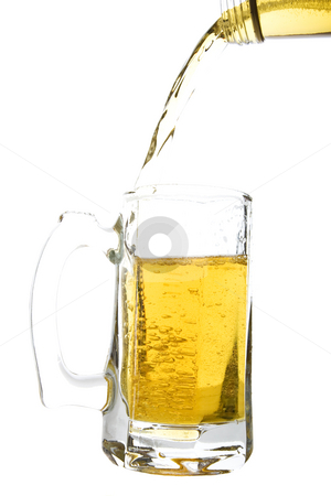 Pouring a Beer stock photo, Beer being poured into a beer mug.  Shot on white background. by Brenda Carson